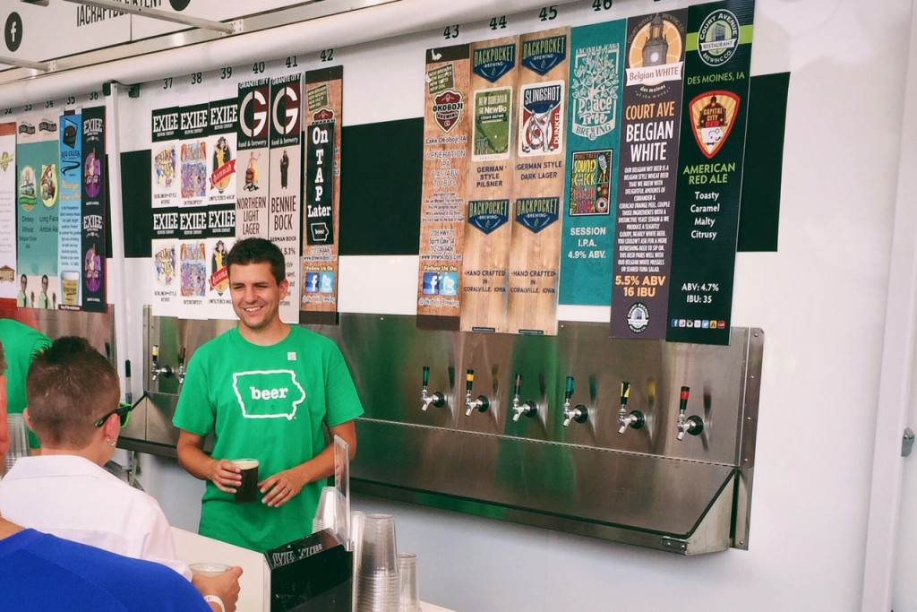 The Des Moines Brewster pouring beers at the Iowa State Fair - Iowa Craft Beer Tent